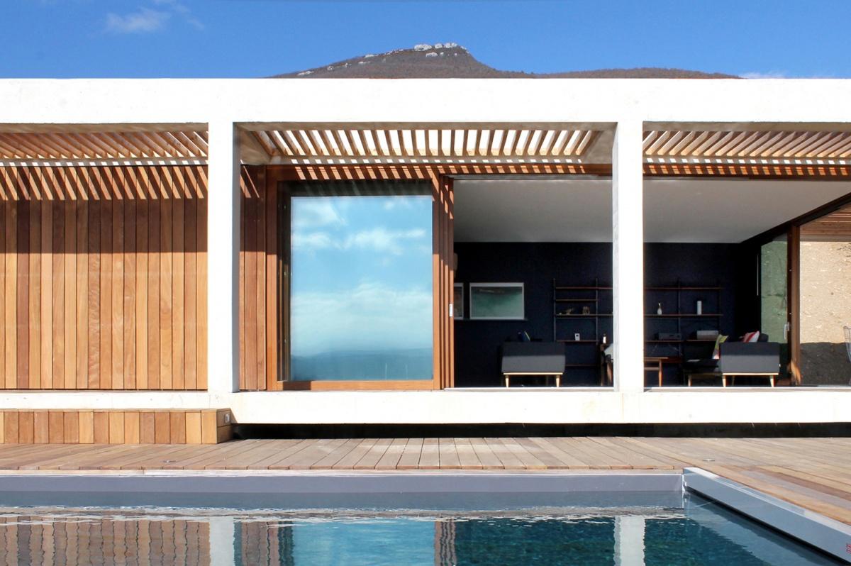 Maison de vacances béton et ossature bois : piscine